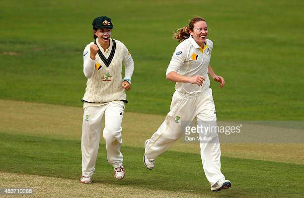 Sarah Coyte and Nicole Bolton of Australia celebrate the wicket of Heather Knight of England during day two of the Kia Women's Test of the Women's...