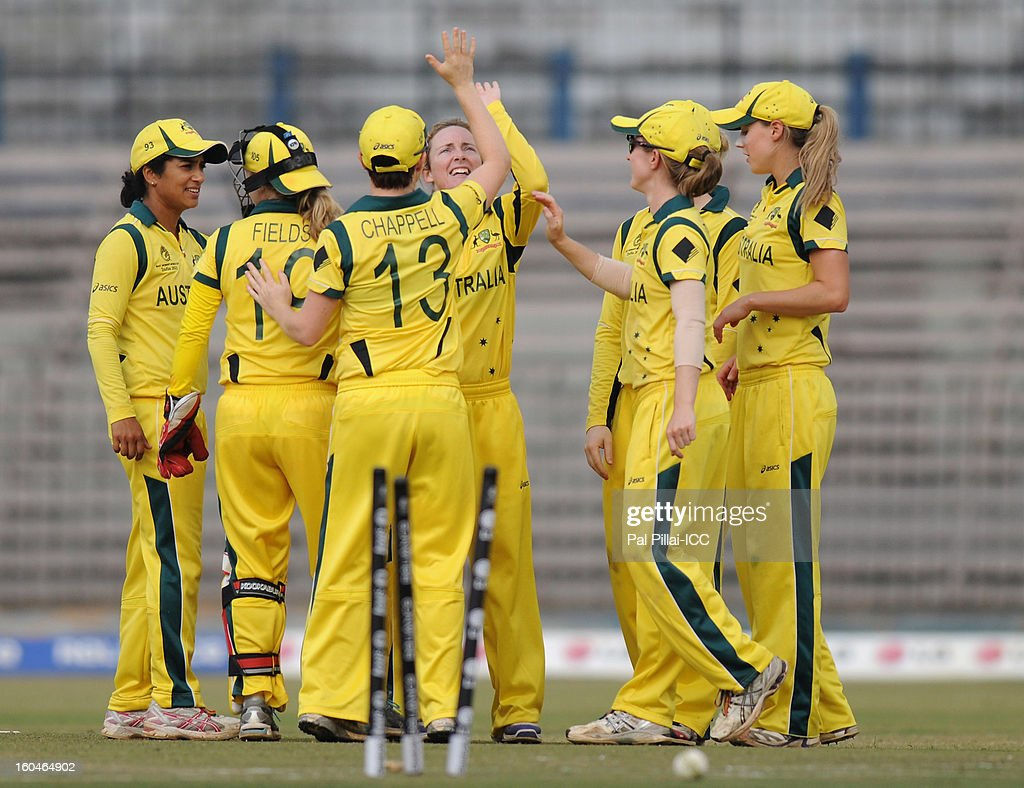 Sarah Coyte of Australia celebrates a wicket with teammates during the second match of ICC Womens World Cup between Australia and Pakistan, played at the Barabati stadium on February 1, 2013 in Cuttack, India.