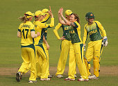 Sarah Coyte of Australia is congratulated by her teammates after dismissing Tammy Beaumont of England during the Final of the ICC Women's World...