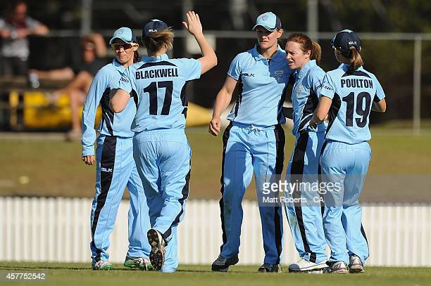 Sarah Coyte of New South Wales celebrates a wicket with team mates during the women's T20 match between Queensland and New South Wales at Allan...