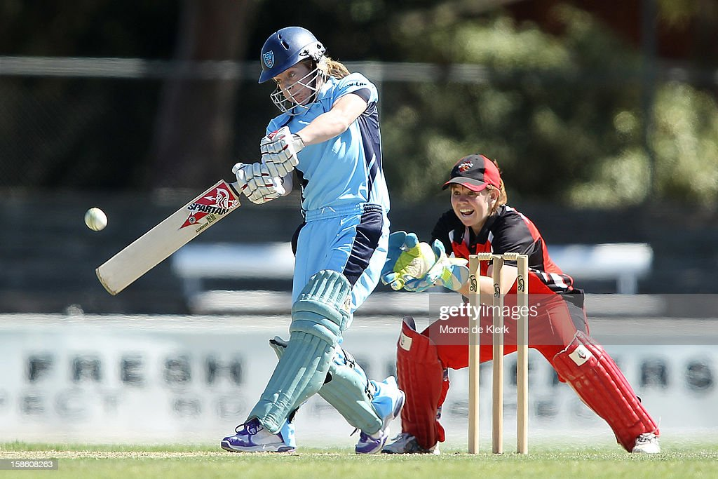 Sarah Coyte of the Breakers bats in front of Tegan McPharlin of the Scorpions during the women's Twenty20 match between the South Australia Scorpions and the New South Wales Breakers at Prospect Oval on December 21, 2012 in Adelaide, Australia.