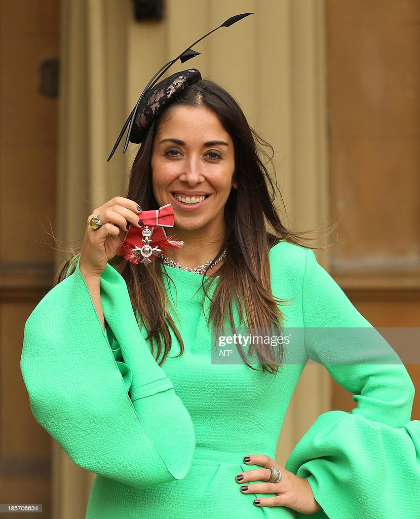 Sarah Curran, founder of My-Wardrobe.com holds her medal after being made a Member of the Order of the British Empire (MBE) by Britain's Prince Charles during an Investiture ceremony at Buckingham Palace on OCtober 23, 2013.