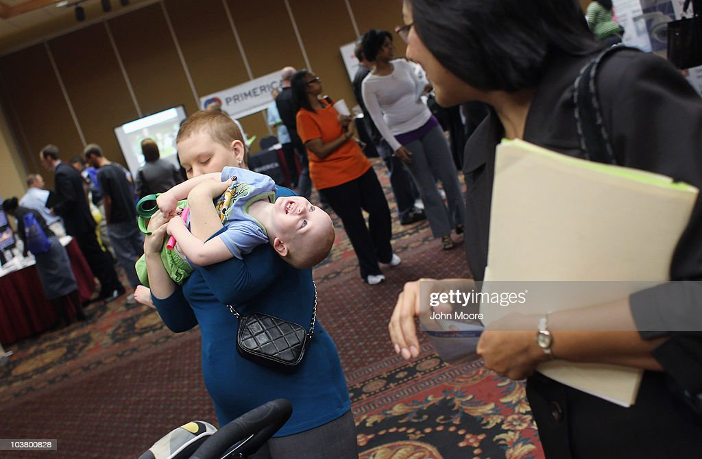 Sarah Dailey entertains her son Jude, 15-months, between meeting potential employers at a career fair on September 2, 2010 in Denver, Colorado. Hundreds of unemployed and underemployed Coloradans turned out for the event to try and find work. The federal government will announce its monthly national unemployment figures on Friday.