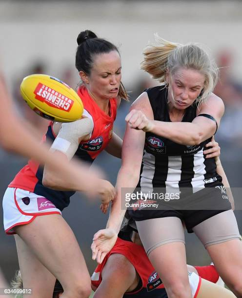 Sarah D'arcy of the Magpies is tackled by Daisy Pearce of the Demons during the round two AFL Women's match between the Collingwood Magpies and the...