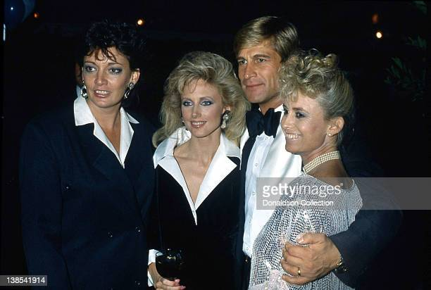 Sarah Douglas Morgan Fairchild Simon MacCorkindale Susan George pose for a portrait at an event in 1985 in Los Angeles California