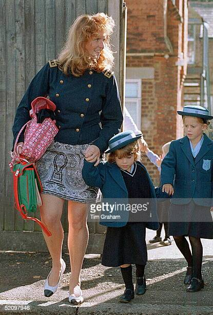 Sarah Duchess Of York Holding Her Daughter Princess Eugenie's Hand On Her First Day At Upton House School In Windsor With Them Is Big Sister Princess...