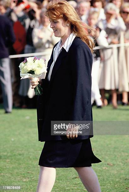 Sarah Duchess of York holds a bouquet of flowers at Guards Polo Club in Windsor Great Park on September 11 1988 in Windsor England