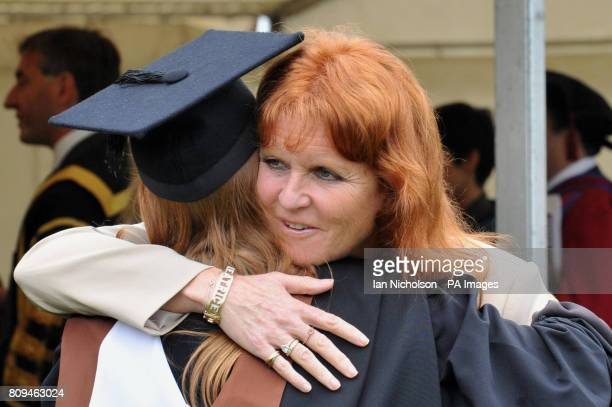 Sarah Duchess of York hugs her daughter Princess Beatrice following her graduation ceremony at Goldsmiths College London