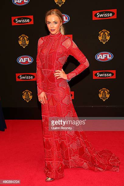 Sarah Dunn the partner of Jarryd Roughead of Hawthorn arrives at the 2015 Brownlow Medal at Crown Palladium on September 28 2015 in Melbourne...
