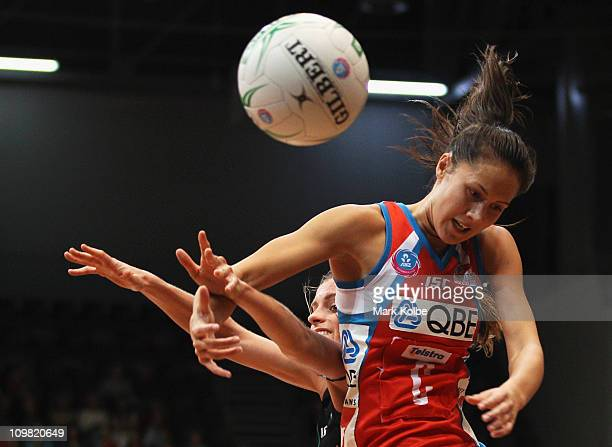 Sarah Ebbott of the Fever and Courtney Tairi of the Swifts compete for the ball during the round four ANZ Championship match between the Sydney...