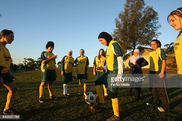 Sarah El Adib wearing a hijab front left trains with fellow soccer players at an under16 girls Lakembaroos training session 6 July 2006 SHD Picture...