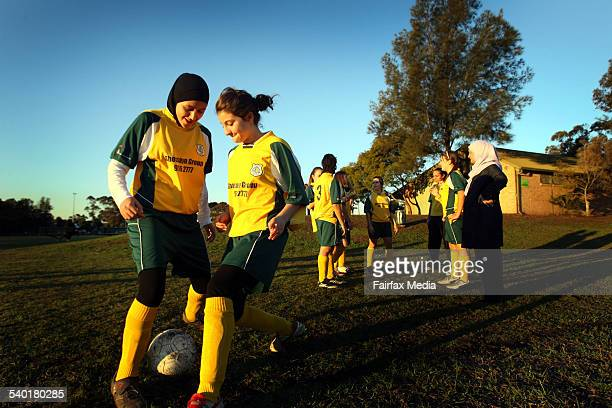 Sarah El Adib wearing a hijab front left trains with fellow soccer player Geenan Osman at an under16 girls Lakembaroos training session 6 July 2006...