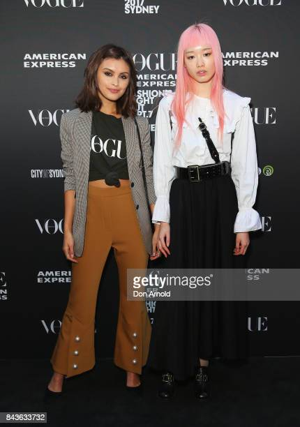 Sarah Ellen and Fernanda Ly pose during Vogue American Express Fashion's Night Out 2017 on September 7 2017 in Sydney Australia