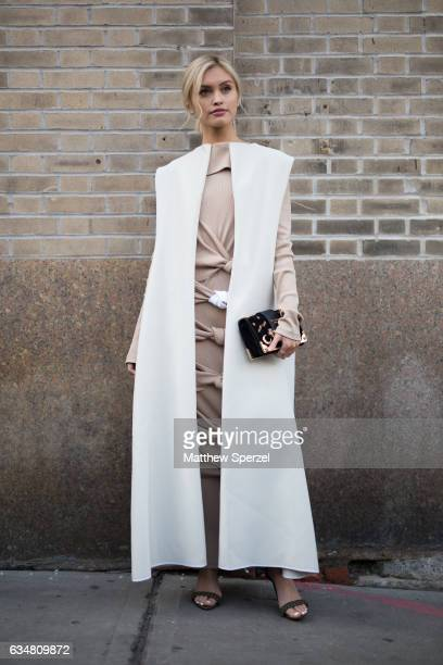 Sarah Ellen is seen attending Dion Lee during New York Fashion Week wearing a long white coat and tan knotted dress on February 11 2017 in New York...