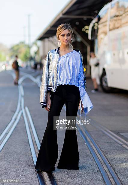 Sarah Ellen wearing a silver jacket from LIFEwithBIRD a blue Georgia Alice off shoulder top with long wide sleeves black wide Ellery pants outside...