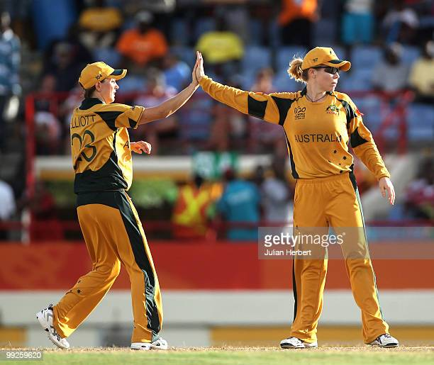 Sarah Elliott and Alex Blackwell of Australia celebrate the dismissal of Jhulan Goswami of India hits out during the ICC Womens World Cup Twenty20...