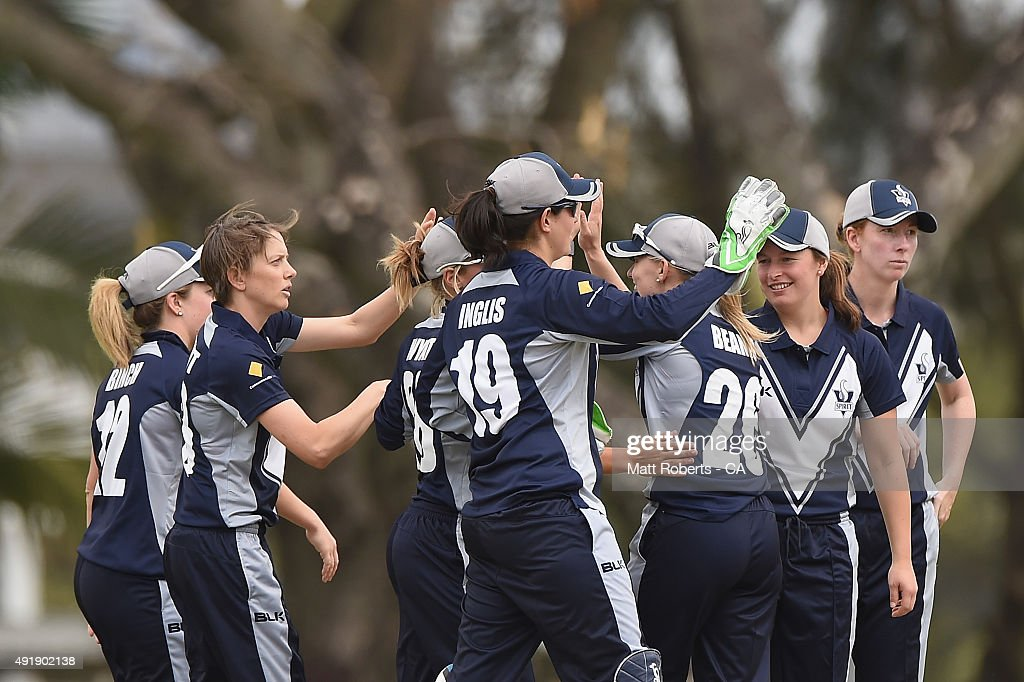 Sarah Elliott of the Spirit celebrates a wicket with team mates during the round one WNCL match between Queensland and Victoria at Allan Border Field...