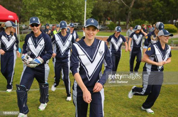 Sarah Elliott of Victoria leads her team onto the field as she plays her 100th WNCL match during the WNCL match between Victoria and the ACT at...