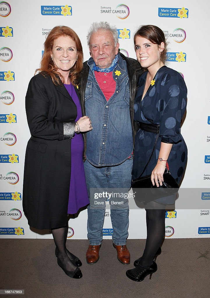 <a gi-track='captionPersonalityLinkClicked' href=/galleries/search?phrase=Sarah+Ferguson+-+Duchess+of+York&family=editorial&specificpeople=160596 ng-click='$event.stopPropagation()'>Sarah Ferguson</a>, Duchess of York, David Bailey and <a gi-track='captionPersonalityLinkClicked' href=/galleries/search?phrase=Princess+Eugenie&family=editorial&specificpeople=160237 ng-click='$event.stopPropagation()'>Princess Eugenie</a> of York attend the launch of Samsung's NX Smart Camera at a charity auction with David Bailey in aid of Marie Curie Cancer Care at the Bulgari Hotel on May 14, 2013 in London, England.