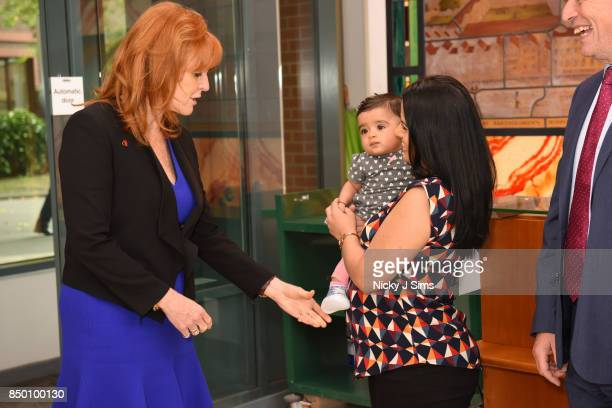 Sarah Ferguson The Duchess of York meets baby Aarya Ghelani and mother Bina Ghelani as she is appointed as an official ambassador of The British...