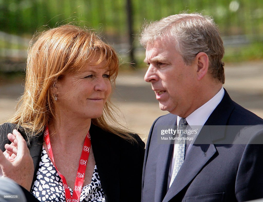 Sarah Ferguson, The Duchess of York talks with ex-husband HRH <a gi-track='captionPersonalityLinkClicked' href=/galleries/search?phrase=Prince+Andrew+-+Duke+of+York&family=editorial&specificpeople=160175 ng-click='$event.stopPropagation()'>Prince Andrew</a>, The Duke of York as they wait for daughter HRH Princess Beatrice of York to complete the Virgin London Marathon as part of the 'Caterpillar Run' Team, consisting of 32 runners tethered together on April 25, 2010 in London, England.