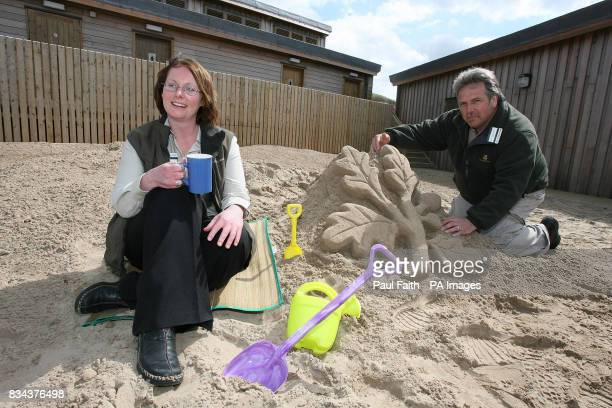 Sarah Field Beach Manager at Portstewart Strand with sand sculptor Tony Hawkins at the beach's newly opened visitor centre