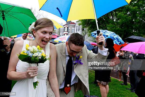 Sarah Gillespie and Adam Johnson celebrate their wedding ceremony on a very rainy morning in a small park at the corner of Kentucky and Independence...