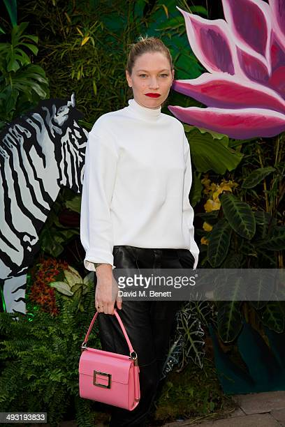 Sarah Gilmour arrives at Roger Vivier Summer Party at Loulou's on May 22 2014 in London England