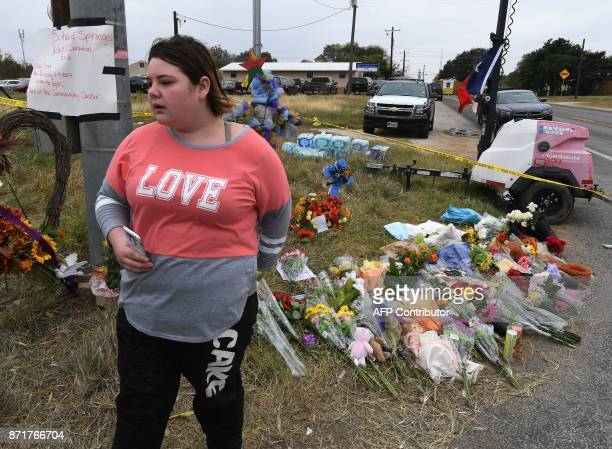 TOPSHOT Sarah Gould who says her best friend was a victim stands outside the First Baptist Church which was the scene of the mass shooting that...