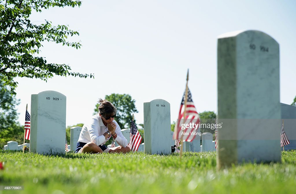 Sarah Greene of Branford, Connecticut, visits the grave site of her husband, U.S. Marine Corps Lieutenant Colonel David S. Greene who was killed in 2004 in Iraq, at Arlington National Cemetery May 25, 2014 in Arlington, Virginia. Americans across the nation observe the Memorial Day this weekend to remember the men and women who died while serving in the U.S. military.