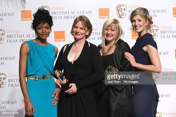 Sarah Greenwood and Katie Spencer with the award for Production Design with presenters Rosamund Pike and Naommie Harris during the 2008 Orange...