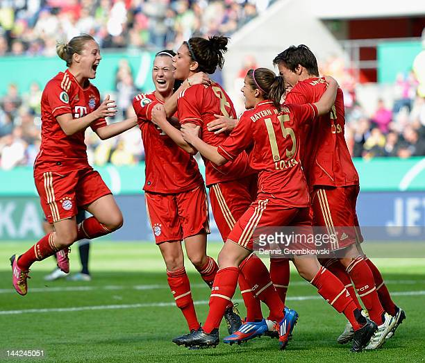 Sarah Hagen of Muenchen celebrates with teammates after scoring her team's first goal during the Women's DFB Cup Final between 1 FFC Frankfurt and...