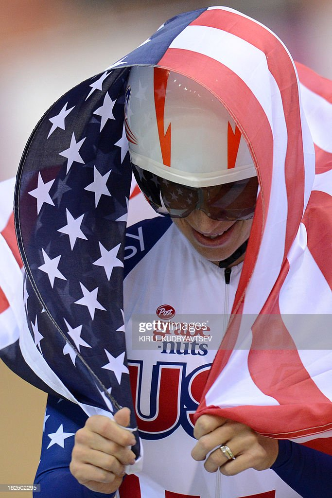 US Sarah Hammer celebrates a gold medal in UCI Track Cycling World Championships Women's 500 m Time trial event fo the Omnium in Minsk on February 24, 2013.