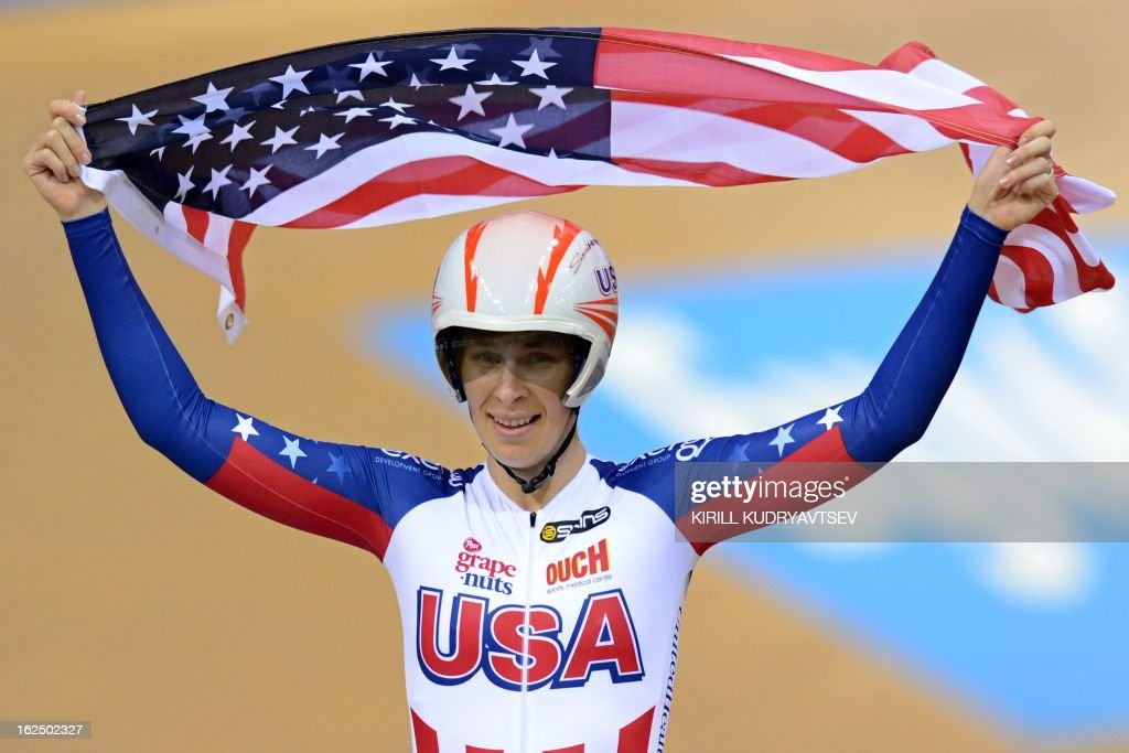 US Sarah Hammer celebrates a gold medal in UCI Track Cycling World Championships Women's 500 m Time trial event fo the Omnium in Minsk on February 24, 2013. AFP PHOTO/KIRILL KUDRYAVTSEV