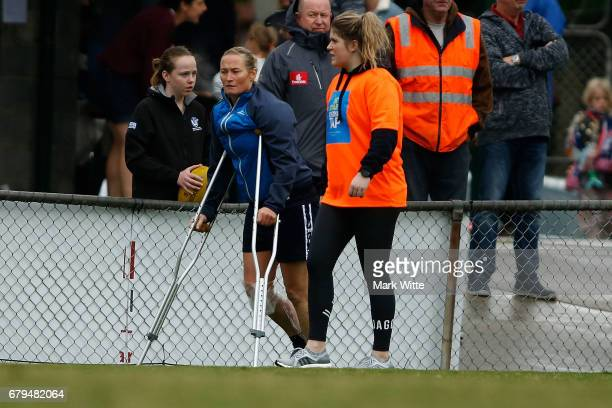 Sarah Hammond of Darebin Falcons walks around the boundry after injuring her knee in the first half of the round one VFL Women's match between the...
