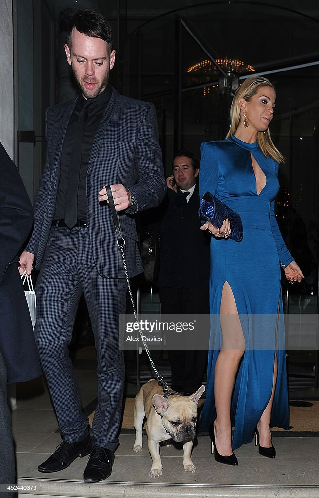 <a gi-track='captionPersonalityLinkClicked' href=/galleries/search?phrase=Sarah+Harding&family=editorial&specificpeople=202916 ng-click='$event.stopPropagation()'>Sarah Harding</a> and Mark Foster leave Animal Hero Awards with thier pet pugg sighting on November 28, 2013 in London, England.