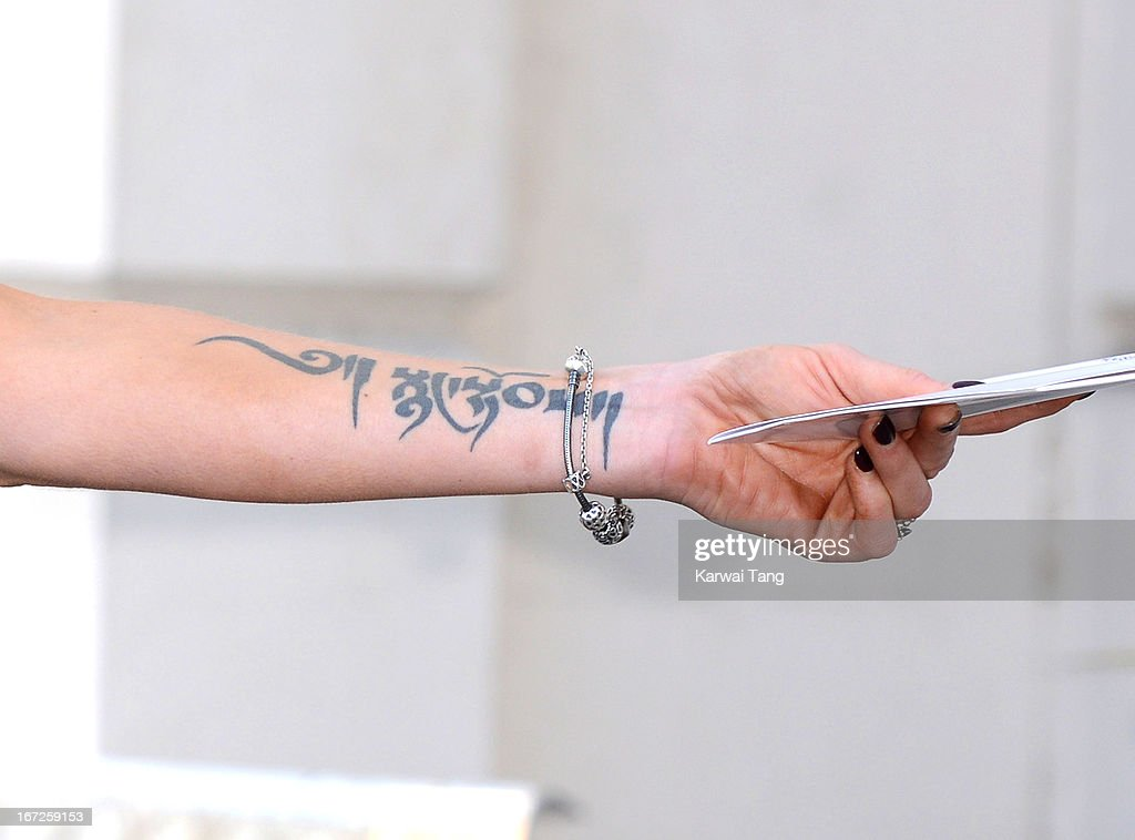 Sarah Harding (tattoo detail) is unveiled as the new ambassador for the armed forces charity 'Coming Home' at Royal College Of Defence Studies on April 23, 2013 in London, England.