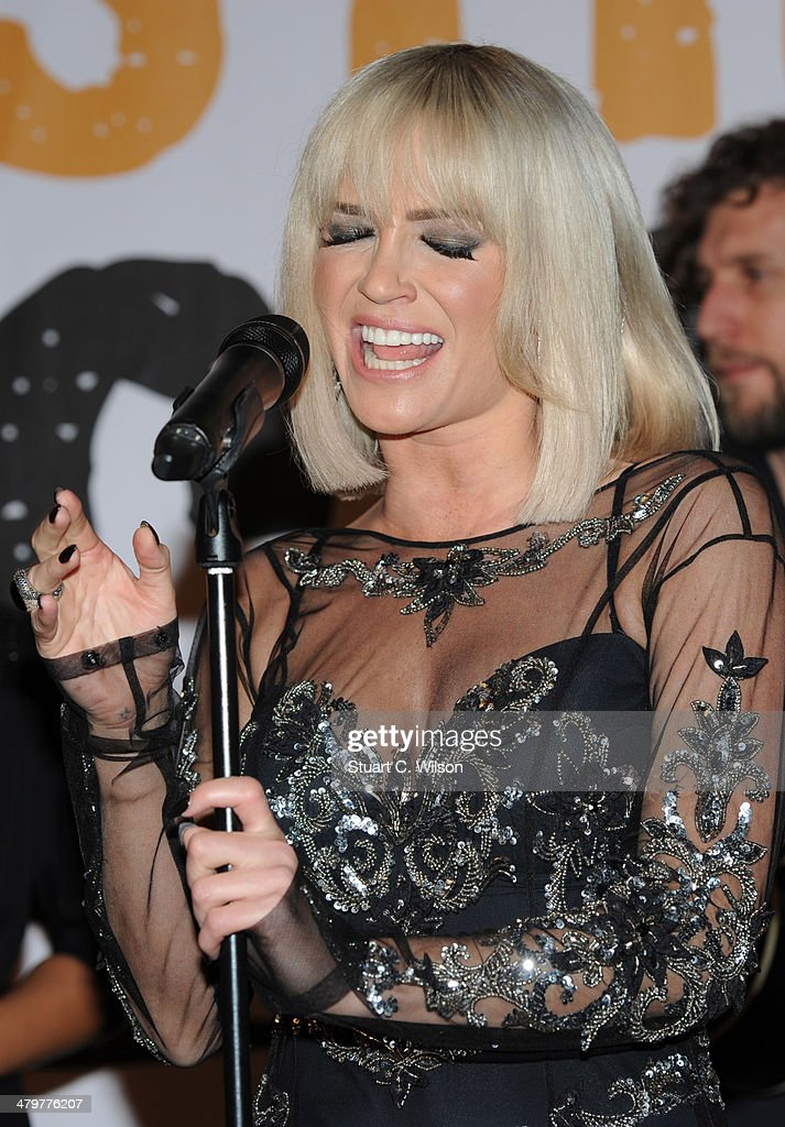 <a gi-track='captionPersonalityLinkClicked' href=/galleries/search?phrase=Sarah+Harding&family=editorial&specificpeople=202916 ng-click='$event.stopPropagation()'>Sarah Harding</a> performs at the Street Child 5th anniversary party at Kensington Palace on March 20, 2014 in London, England.