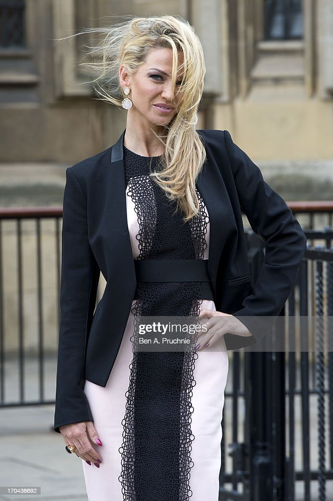 <a gi-track='captionPersonalityLinkClicked' href=/galleries/search?phrase=Sarah+Harding&family=editorial&specificpeople=202916 ng-click='$event.stopPropagation()'>Sarah Harding</a> poses as she makes a visit in her role as ambassador for the Coming Home charity at House of Commons on June 13, 2013 in London, England.