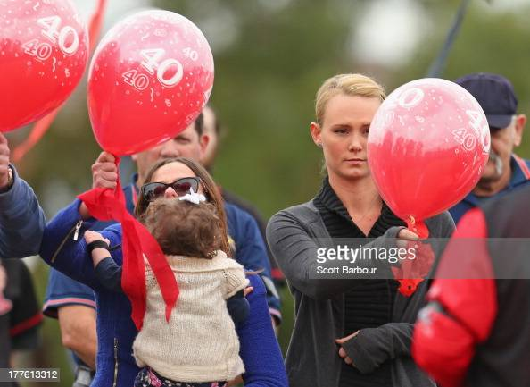 Sarah Harper the girlfriend of Christopher Lane and Erin Lane sister of Christopher Lane holding her daughter Amelia release balloons to celebrate...
