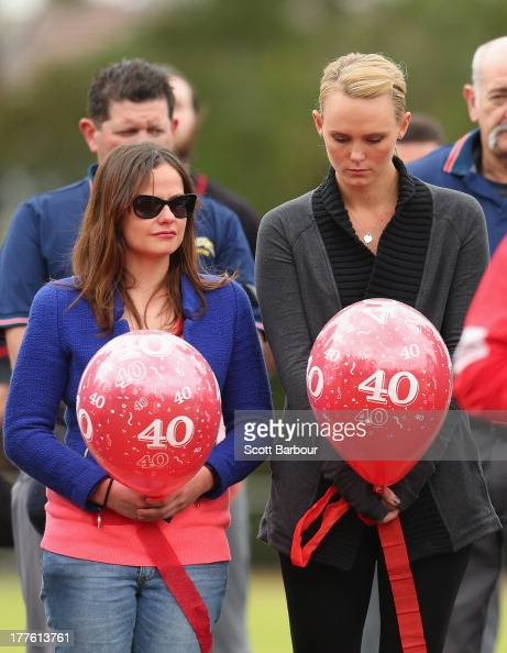 Sarah Harper the girlfriend of Christopher Lane and Erin Lane sister of Christopher Lane stand for a minute's silence and the release of balloons to...