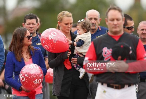 Sarah Harper the girlfriend of Christopher Lane holds Chris's niece Amelia while Erin Lane sister of Christopher Lane looks on as they stand for a...