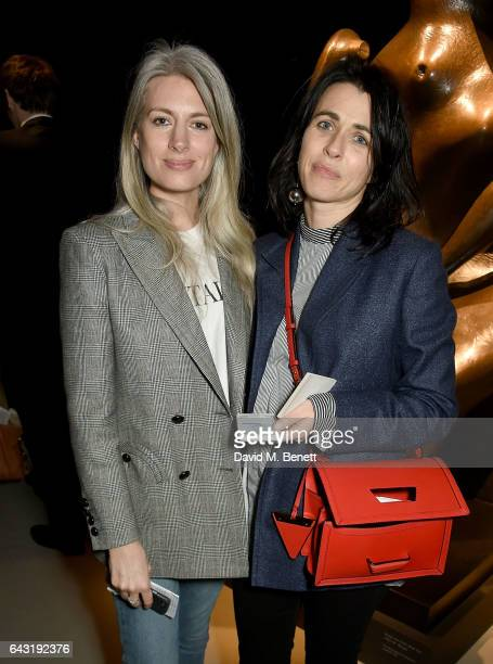 Sarah Harris and Emily Sheffield wearing Burberry attend the Burberry February 2017 Show during London Fashion Week February 2017 at Makers House on...