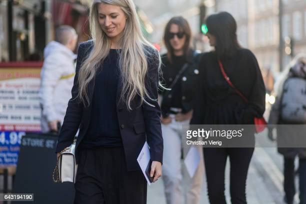 Sarah Harris wearing navy blazer outside JW Anderson on day 2 of the London Fashion Week February 2017 collections on February 18 2017 in London...