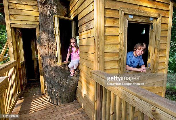 Sarah Hatley left and Jack Hatley pose for photograph in their unique tree house built around an oak in their backyard at their home in Columbus...