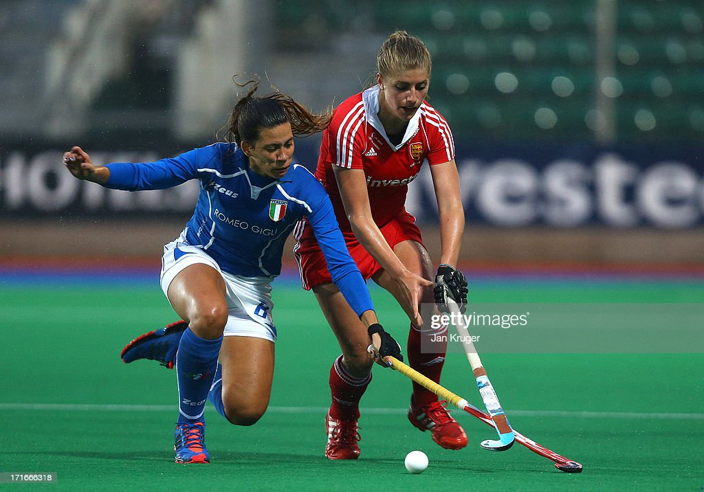 Sarah Haycroft of England battles with Macarena Ronsisvalli of Italy during the Investec Hockey World League quarterfinal match between England and Italy at the Quintin Hogg Memorial Sports Grounds on June 27, 2013 in London, England.