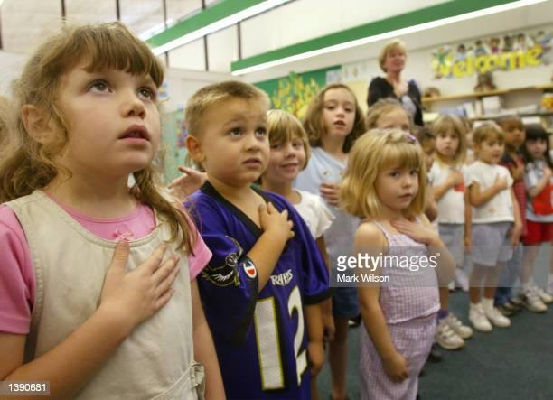 Sarah Henderson and children from Mrs Morrow's kindergarden class at Sunderland Elementry school recite the Pledge of Allegiance September 17 2002 in...
