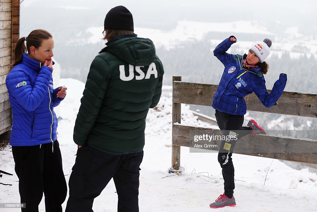 Sarah Hendrickson (R) and Lindsay Van of the USA prepare with coach Paolo Bernardi for the FIS Ski Jumping World Cup Women's HS108 on January 13, 2013 in Titisee-Neustadt, Germany.