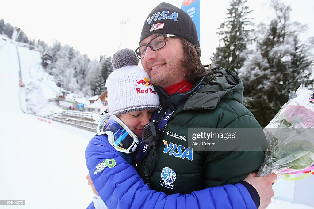 Sarah Hendrickson of the USA hugs coach Paolo Bernardi after winning the FIS Ski Jumping World Cup Women's HS108 on January 12, 2013 in Titisee-Neustadt, Germany.