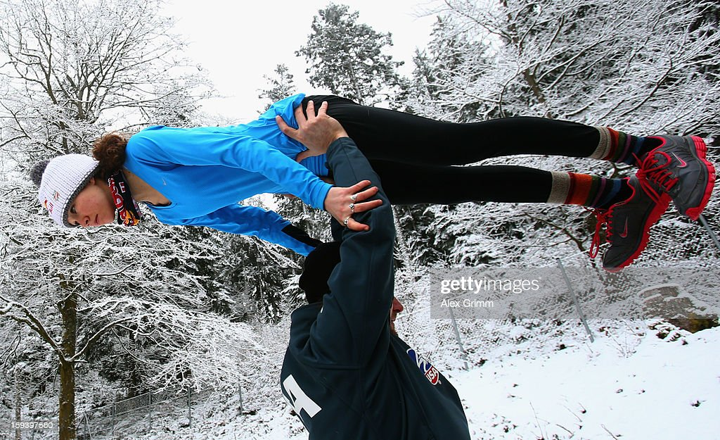 Sarah Hendrickson of the USA prepares with coach Paolo Bernardi for the FIS Ski Jumping World Cup Women's HS108 on January 13, 2013 in Titisee-Neustadt, Germany.